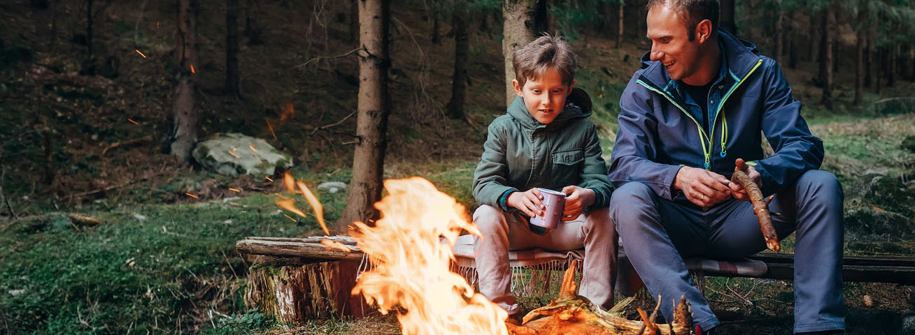 man and son sitting by the fire